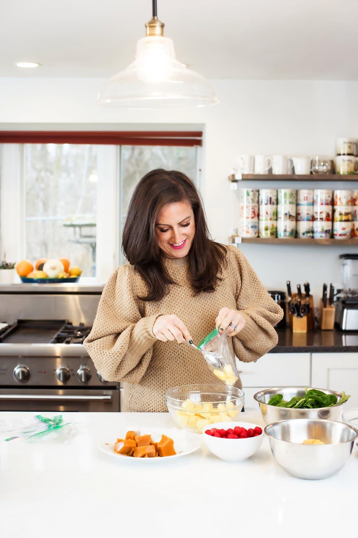 Liz making smoothie freezer bags