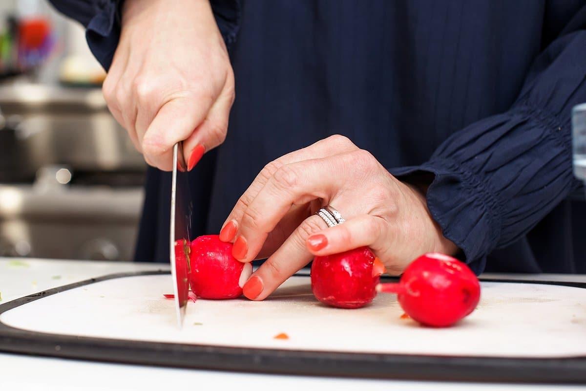 Liz chopping radishes