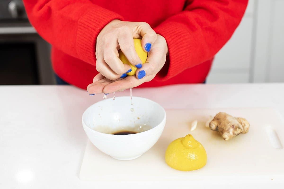 Liz squeezing a lemon