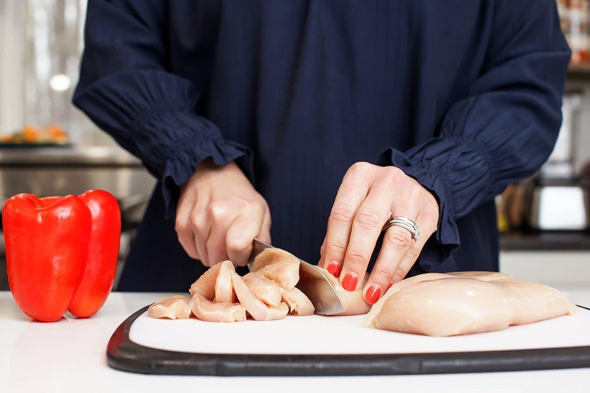 Liz cutting chicken