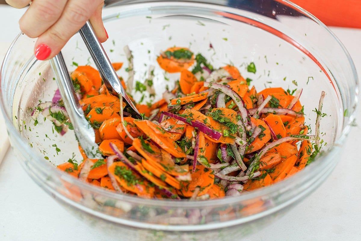 Liz tossing carrot salad