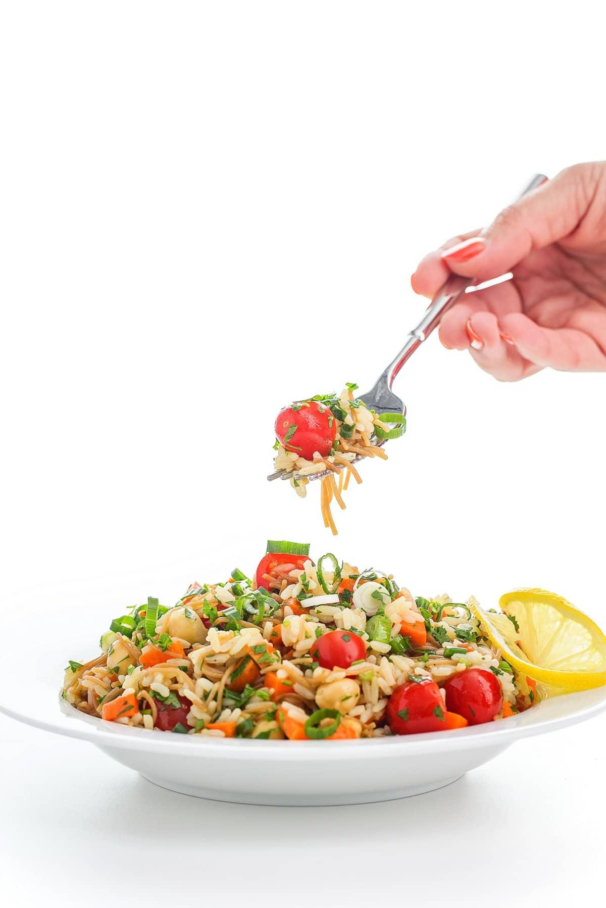 fork full of lebanese rice salad