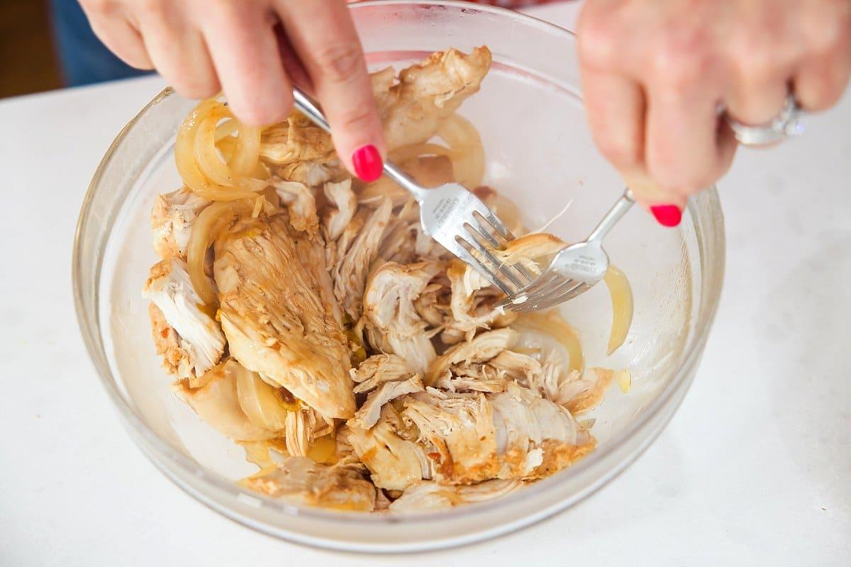 Liz shredding chicken.