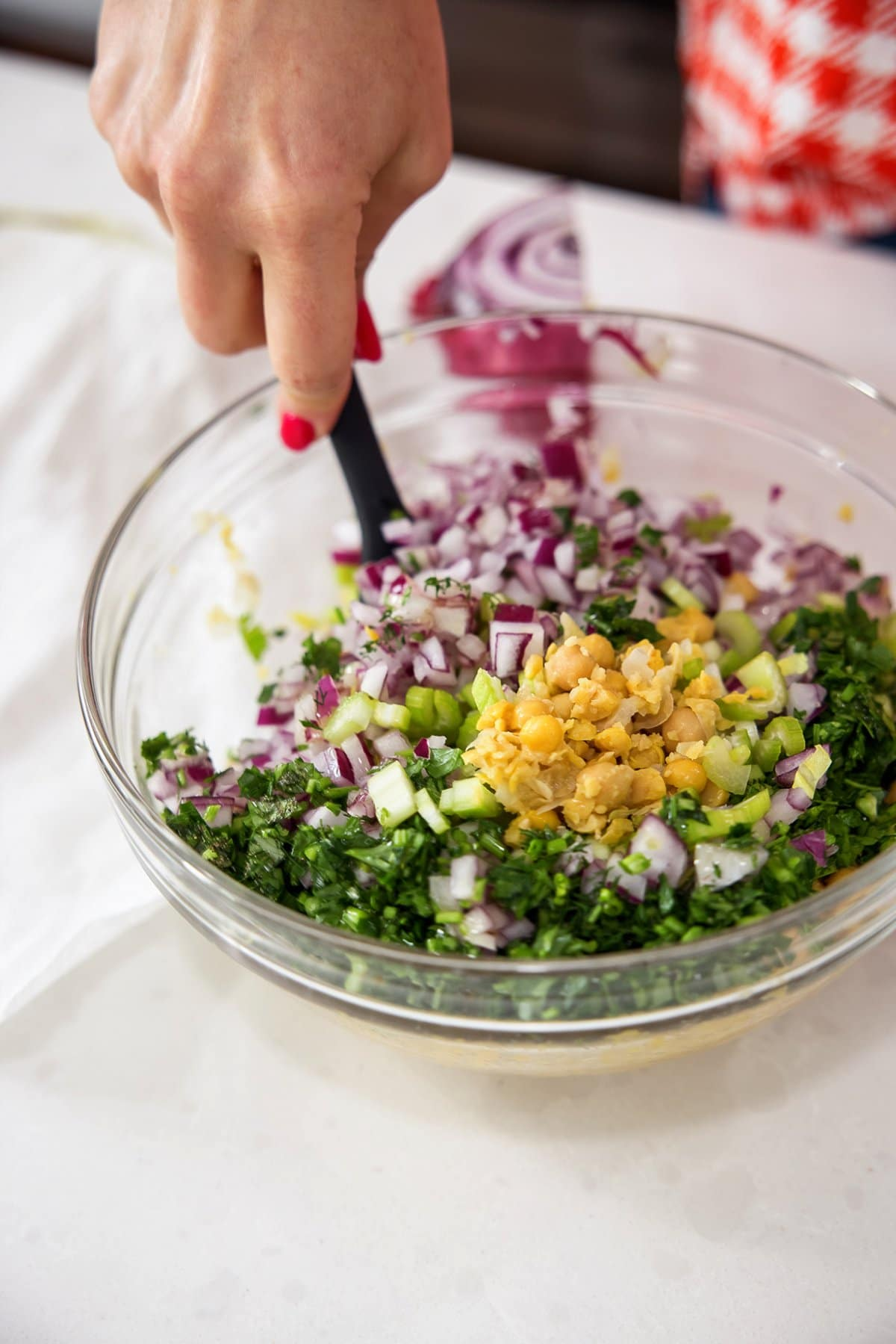 Liz tossing smashed chickpea salad with dill.