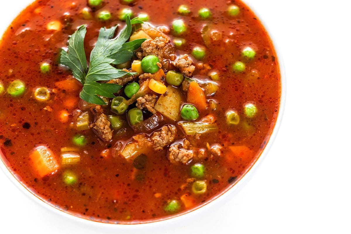 A hearty bowl of lamb vegetable soup.
