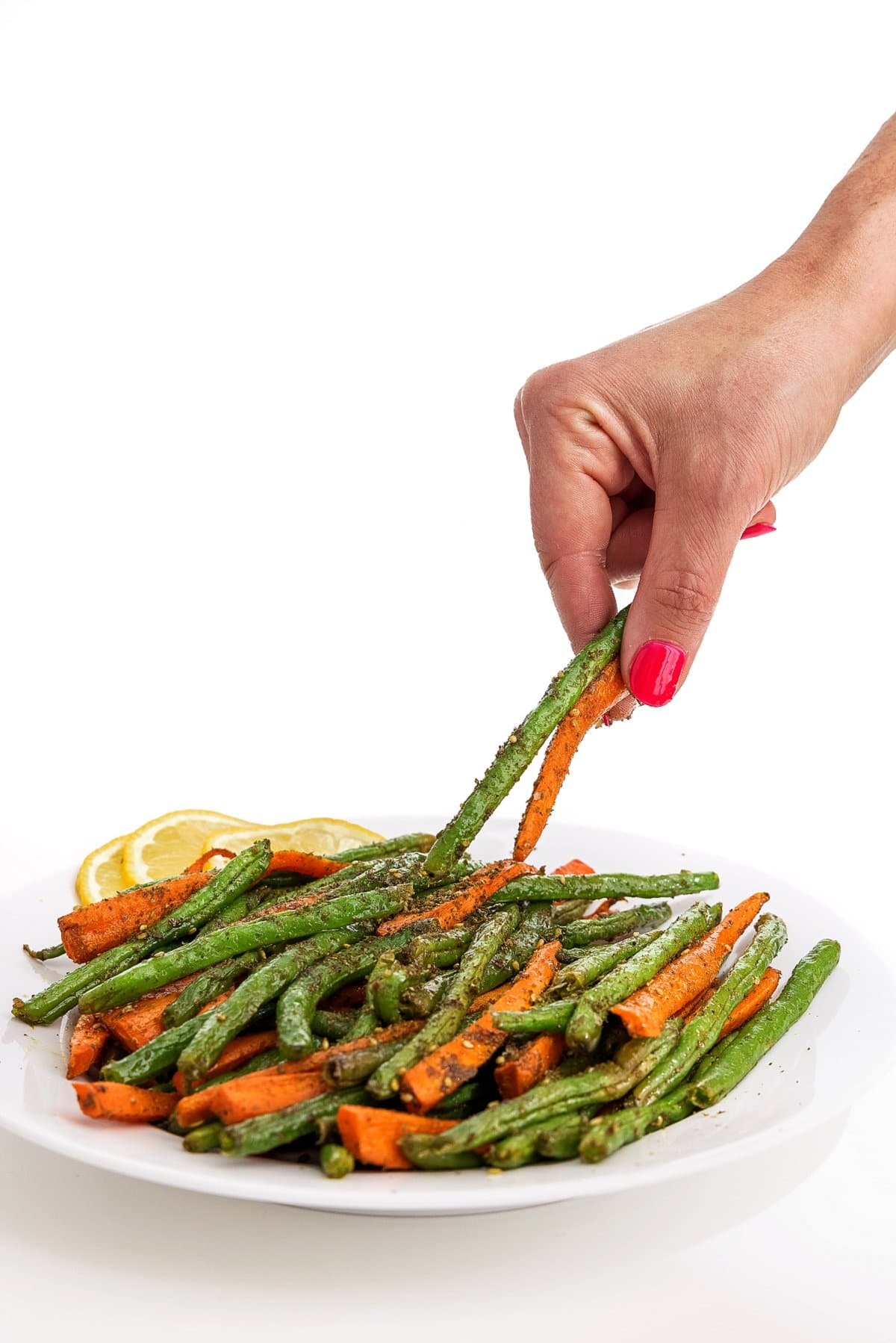 Grabbing roasted carrots and green beans with za'atar.