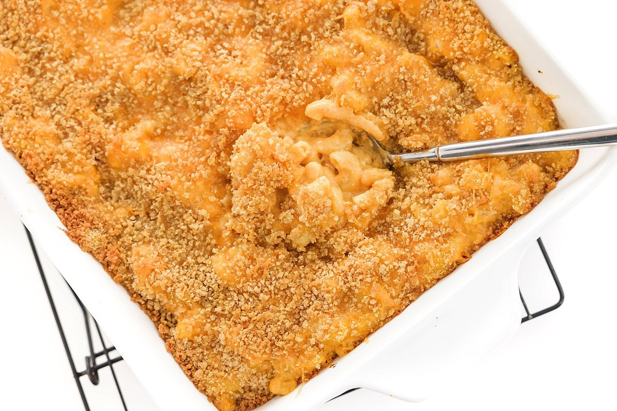 Serving healthy baked mac and cheese with pumpkin.