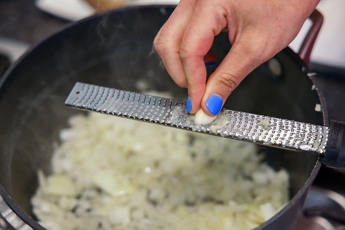 Liz grating garlic.