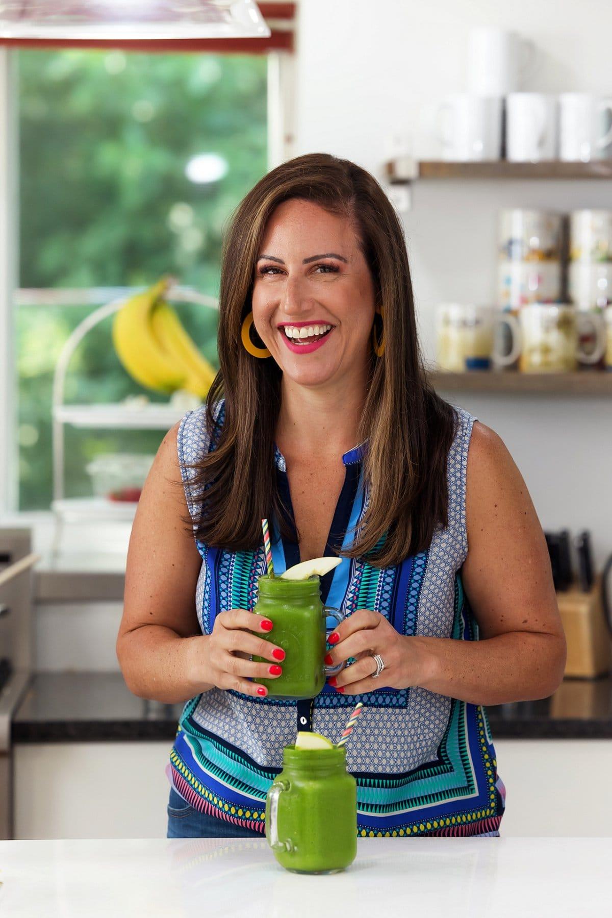 Liz enjoying pineapple mango green smoothie.