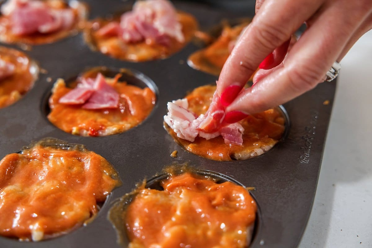 Adding bacon to turkey meatloaf muffins.