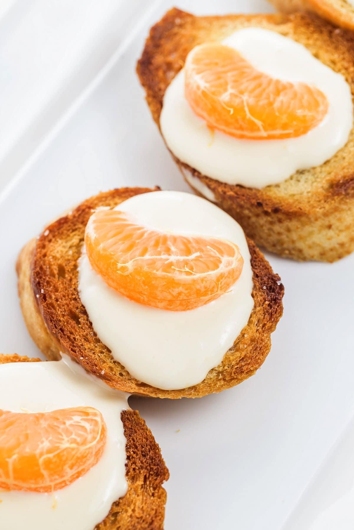 Honey tangerine goat cheese crostini.