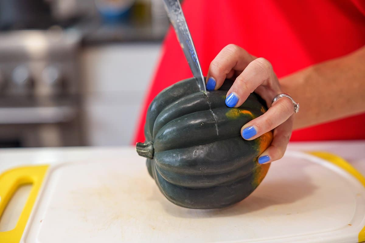 Liz cutting acorn squash.